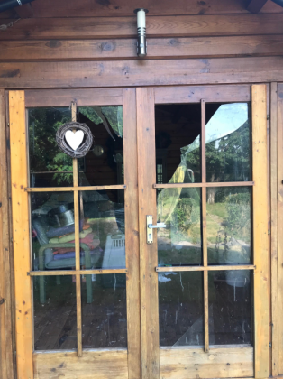 Destroyed windows of the doors from our summerhouse